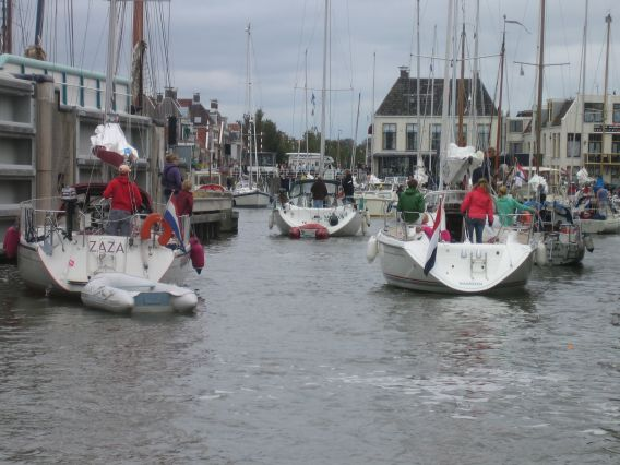 Entering Harlingen with many yachts after the flood gates opened again