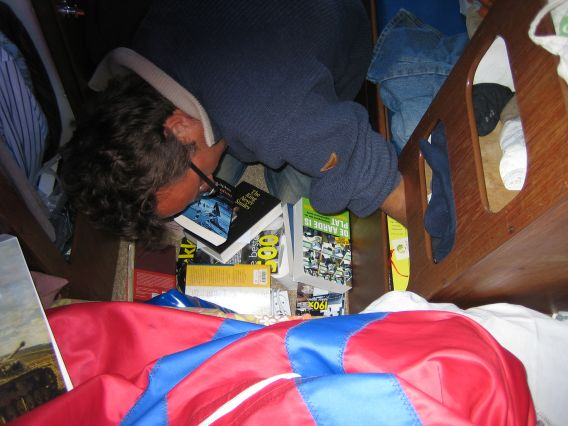 Marnix searching for a book in our ship library